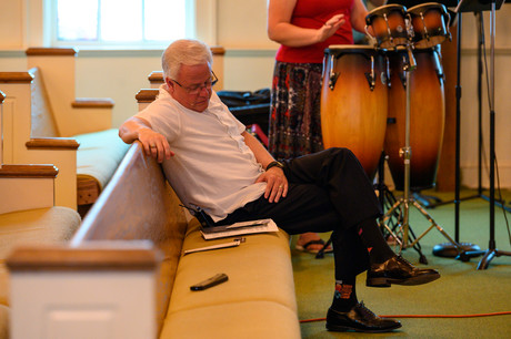 Pastor Phil Wages prepares for his sermon at Winterville First Baptist Church in Winterville, Georgia on Sunday, May 24, 2020. Only the Wages family, technology operators, and worship band members were inside the church.