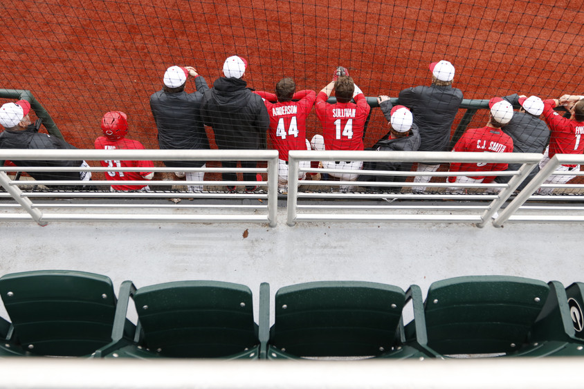 University of Georgia baseball players cheer on their teammates from their dugout in Athens, Georgia on Sunday, Feb. 16, 2020. In their third game of the series, the UGA baseball team beat the University of Richmond Spiders 5-4 to sweep the series. The UGA baseball team is ranked fourth currently.