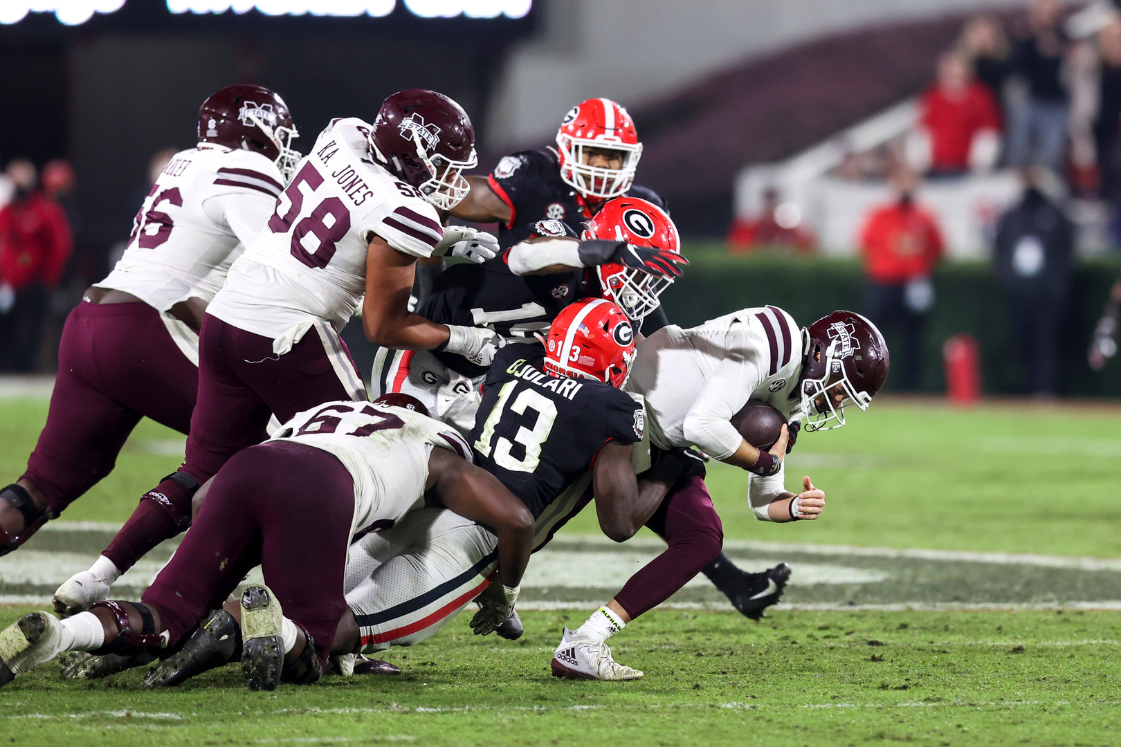 UGA players sack Mississippi State quarterback Will Rogers during the second half of the UGA versus Mississippi State football game in Athens, Georgia on Saturday, Nov. 21, 2020. UGA won the game 31-24.