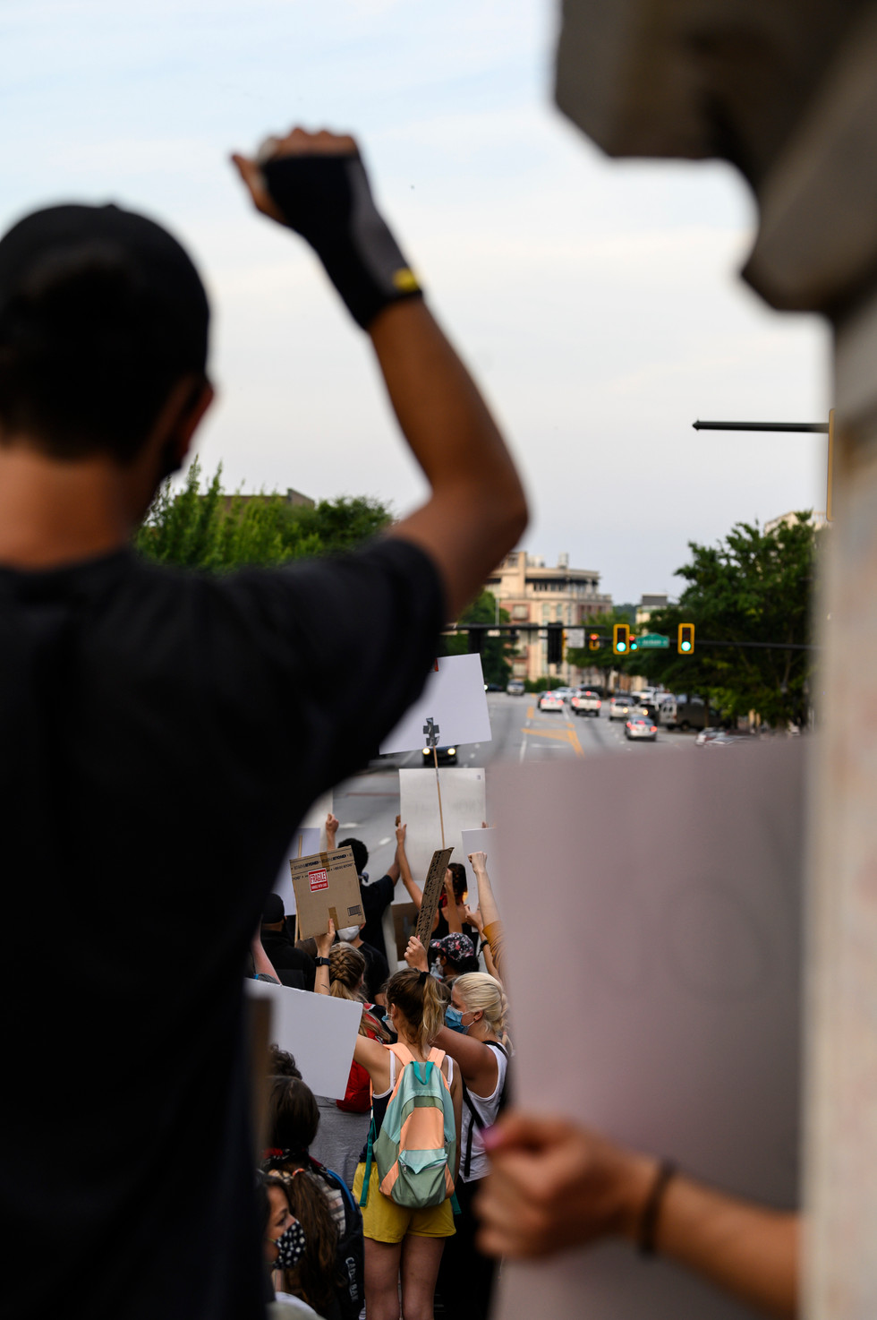 Silent protesters hold signs as passing cars honk in downtown Athens, Georgia on Wednesday, June 3, 2020. This is the fourth consecutive day of protests in Athens as protesters join with those around the world demonstrating in response to the death of George Floyd in police custody.