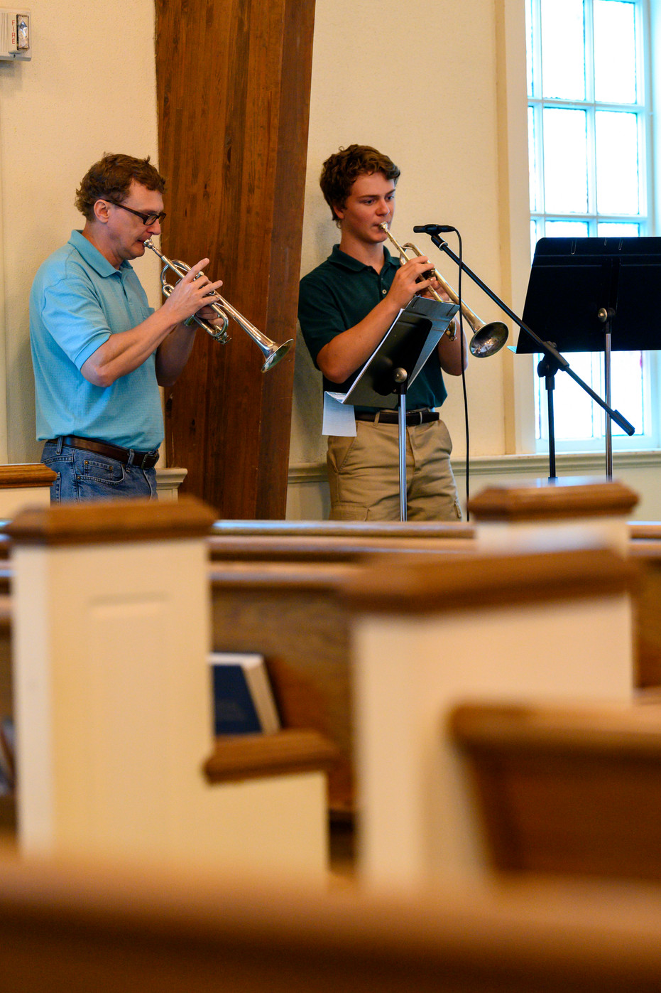 John Bailey plays trumpet with his son Nathan at Winterville First Baptist Church in Winterville, Georgia on Sunday, May 24, 2020. A special microphone broadcasts the music to live steam channels.