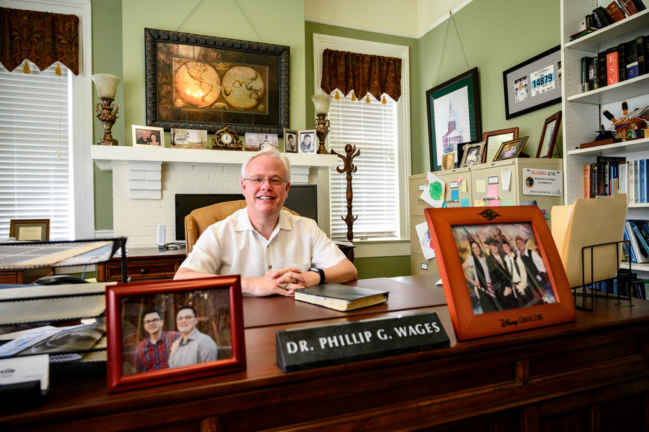 Phil Wages, pastor of Winterville First Baptist Church, poses for a portait at his desk in Winterville, Georgia on Sunday, May 24, 2020.