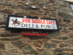 side saddle cafe sign