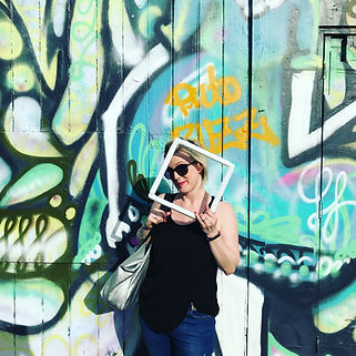 blonde woman with grafitti