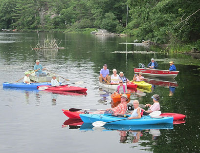 Wes Harbor Pond Watershed Association members boating near the dam and siphon
