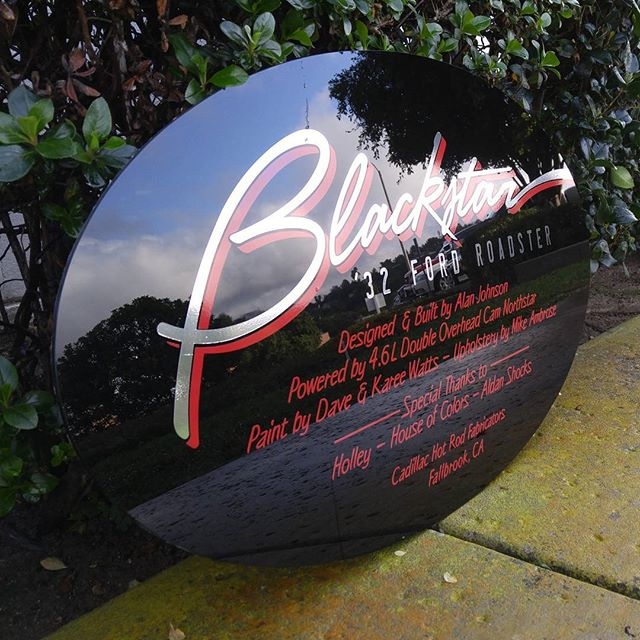 Black plexiglass sign