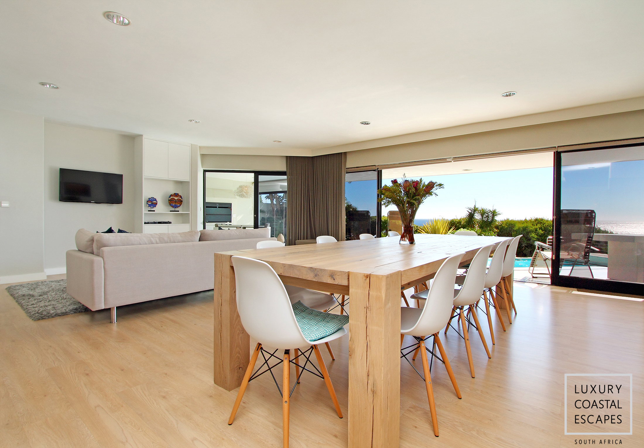 Dining and TV Area leading onto Pool Area