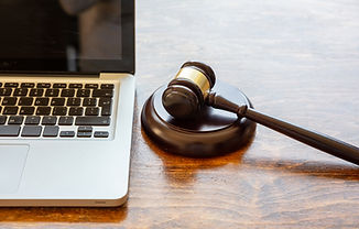 judge-gavel-and-a-laptop-wooden-backgrou