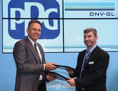 DNV GL's George Dimopoulos, Head of R&D and advisory Greece and PPG's Tom Molenda, Global Director Marine Coatings sign the collaboration agreement.