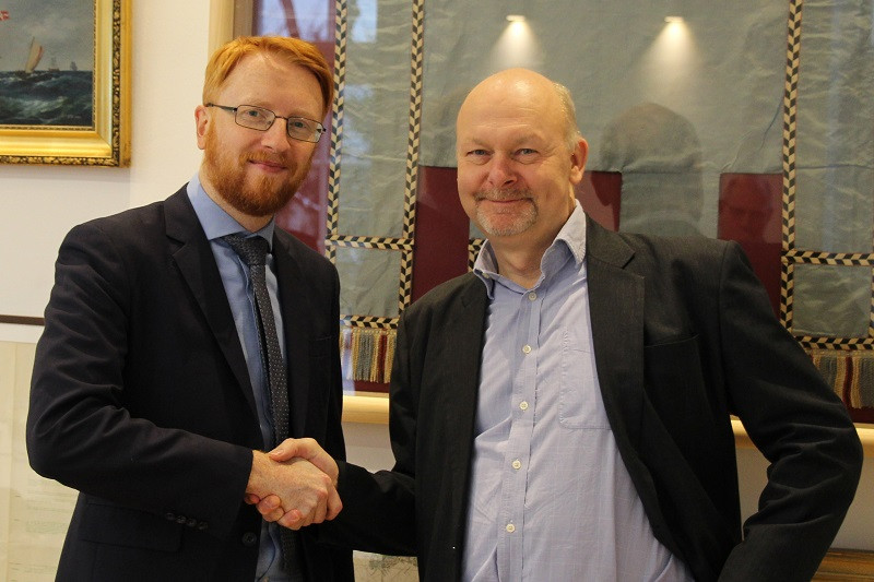 Picture shows: Richard Doherty from CIRM (left) and Aron Frank Sørensen from BIMCO (right) congratulate each other after finalizing the Standard on Software Maintenance of Shipboard Equipment text.