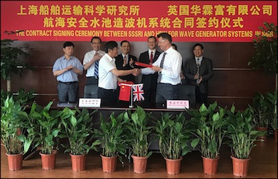 (From left) Prof Lu Jiaming, Vice-President of the Shanghai Ship and Shipping Research Institute (SSSRI) and Dr Bruce Tomlinson, Chief Executive of HR Wallingford, shake hands at the contract signing ceremony for the Wave Generation System.