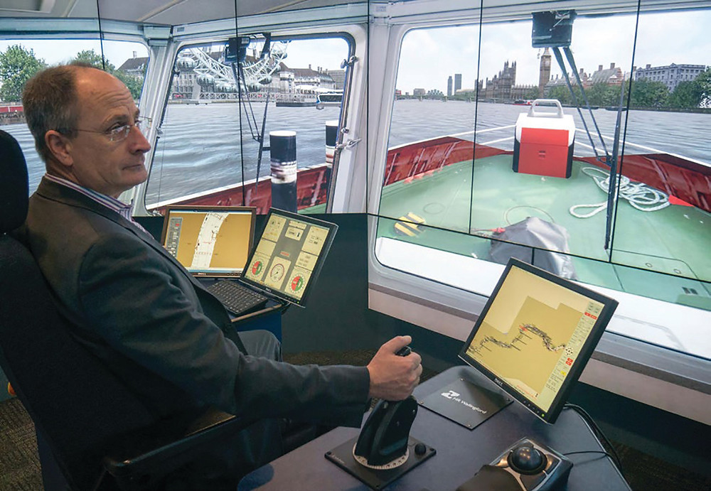 Andy Mitchell, CEO of Tideway, at the helm of a tug in the Thames simulation