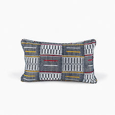 This hand-made Waraniene cushion pays tribute to the cotton growers in the Savanes District of Côte d'Ivoire known for its vast cotton cultivation and one of Africa's largest producers of this much valued material.