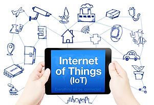 Hand Hold Tablet With Internet Of Things (iot) Word On Screen With Doodle Icon On White Background.j