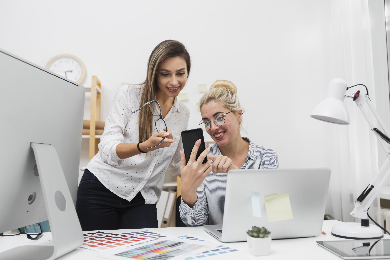 women-looking-phone-office