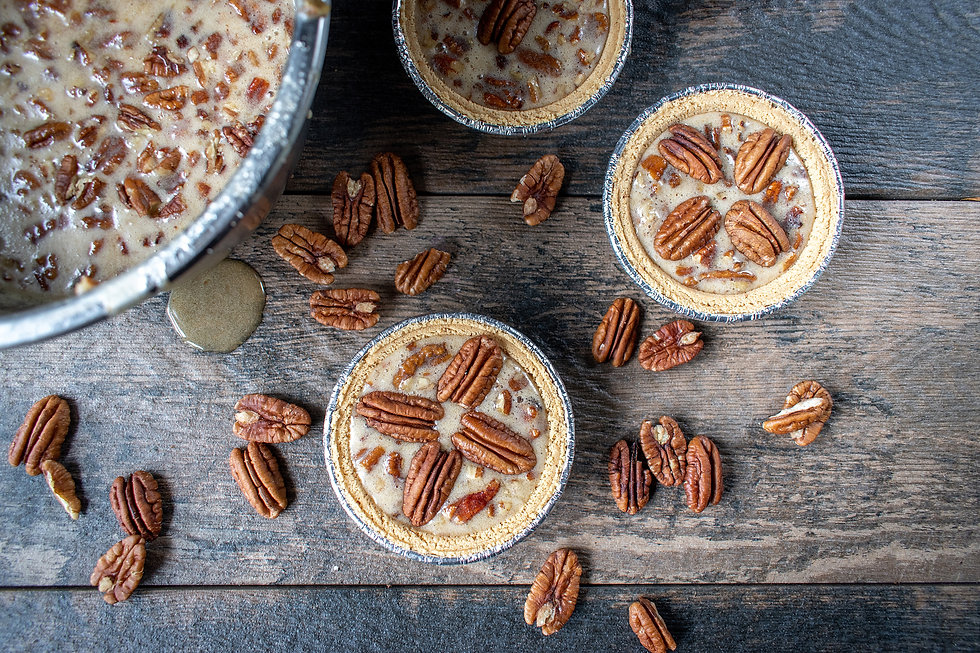 unbaked-mini-pecan-pies-on-rustic-table-