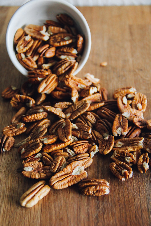 whole-pecans-spilling-from-small-white-b