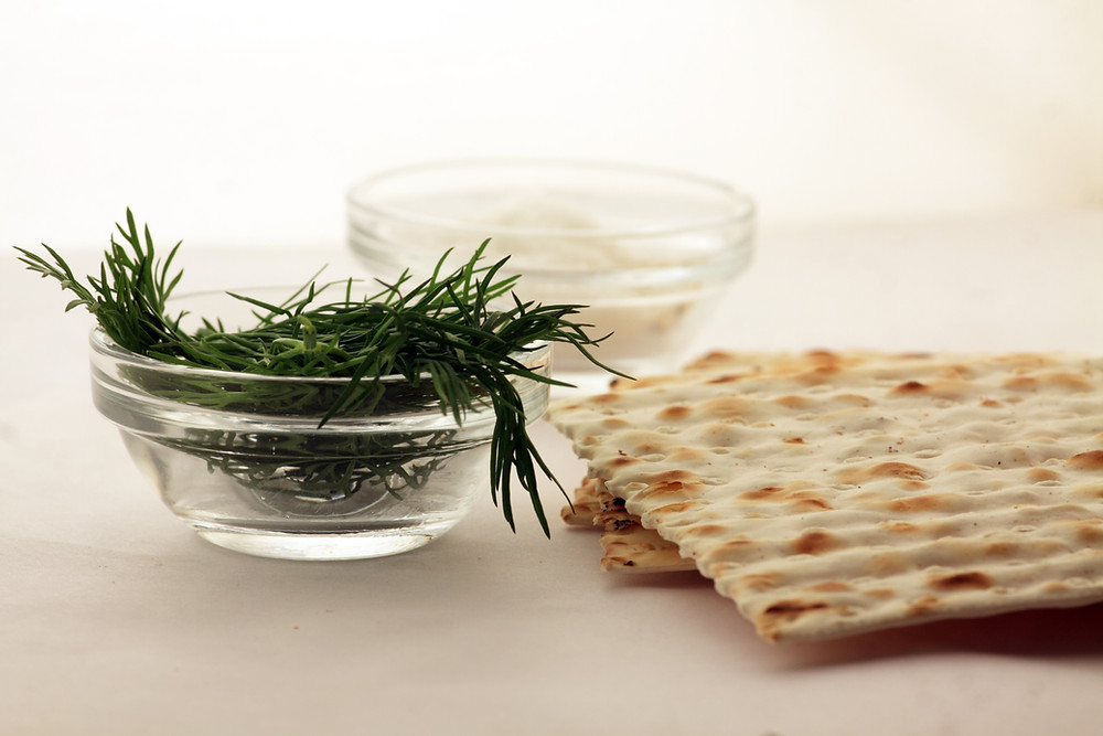 Two pieces of matzah and some dill.