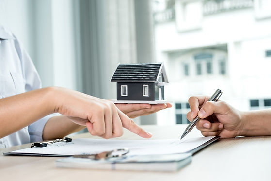 buyer-hand-signs-contract-after-real-est