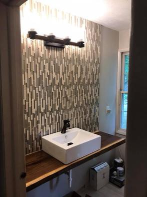 Floating Vanity and bathroom tile remode