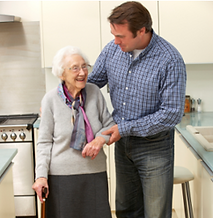 Older woman being helped by younger man
