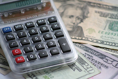 calculator, US money and checkbook