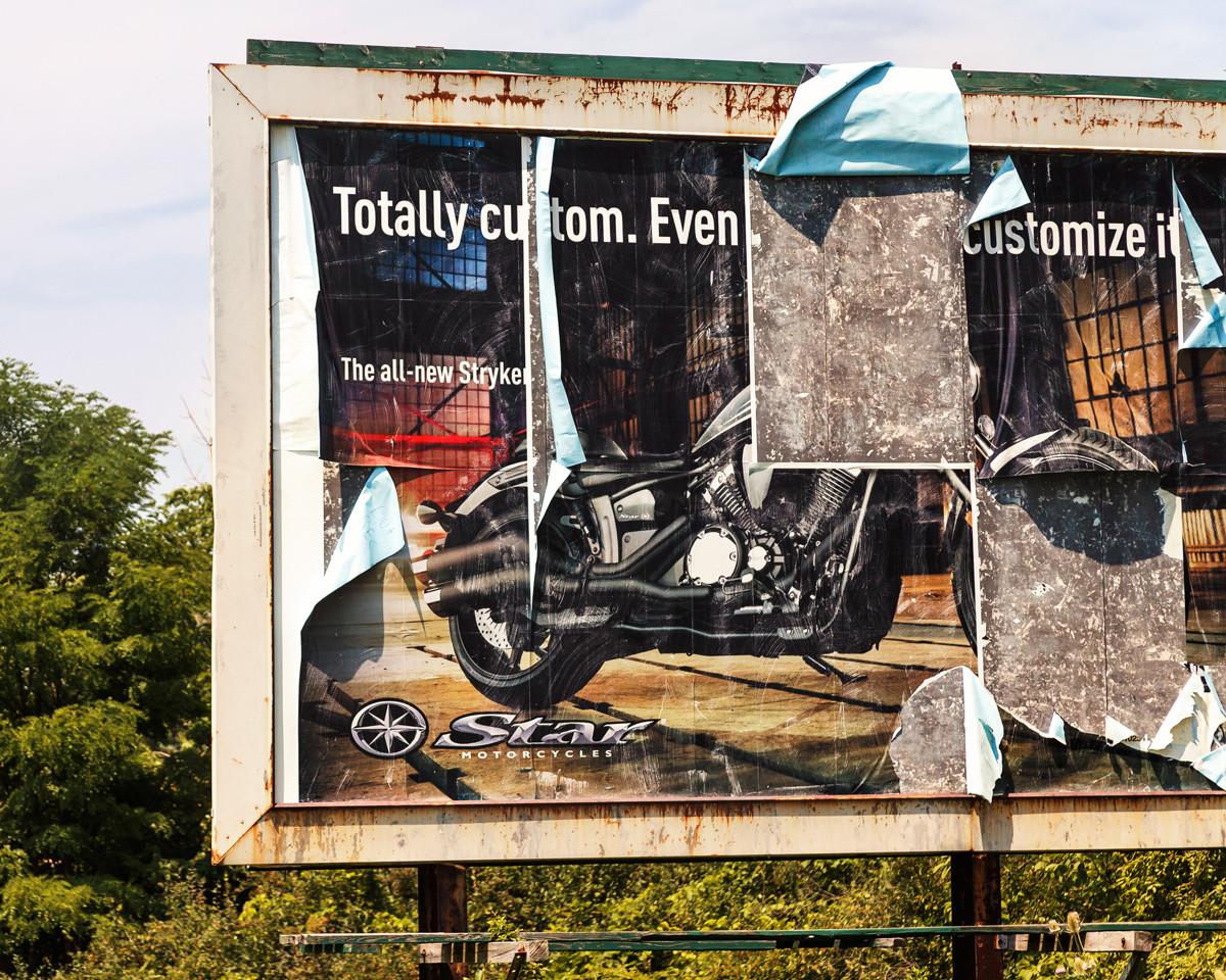 Torn Motorcycle Billboard