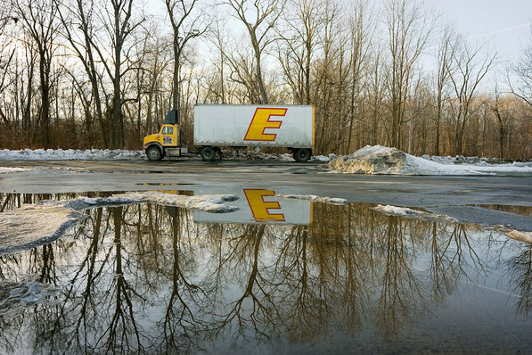 E Truck Sunset Behind the Sunoco