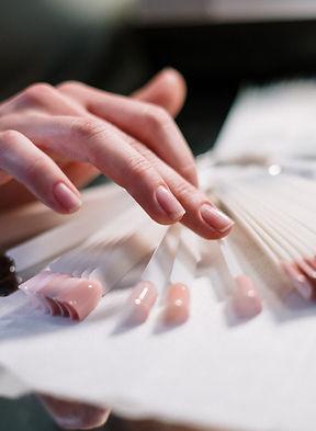 Lady picking nails .jpg