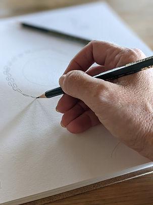 NewEmber_DrawingUpDesigns.jpg