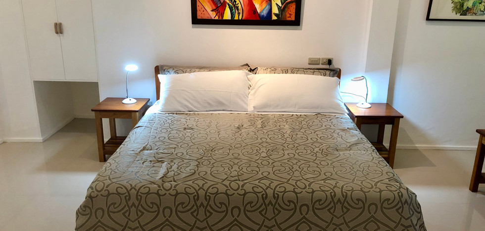 King size bed in the Deluxe Room