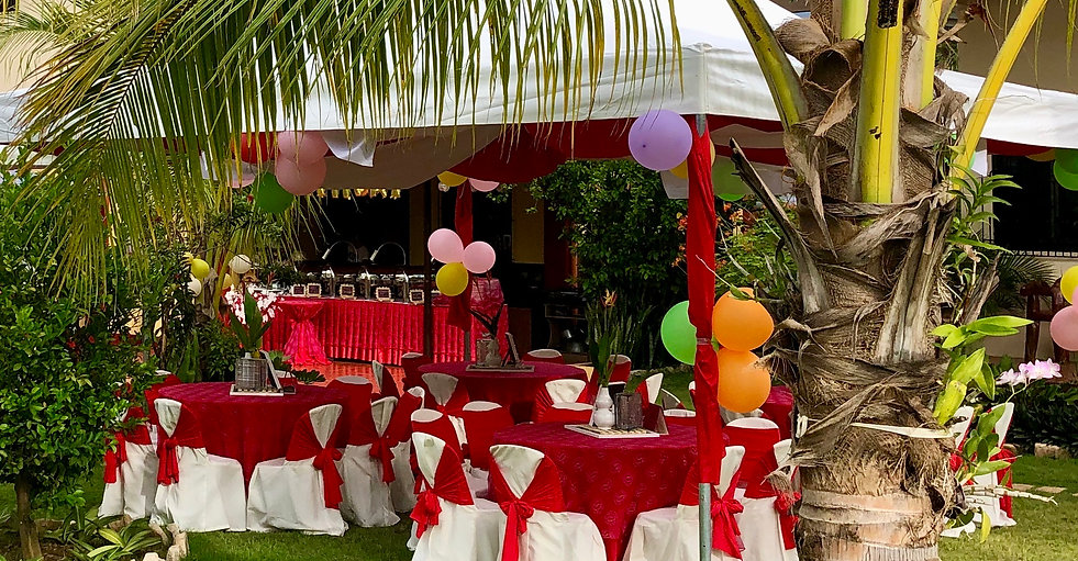 Festively decorated tables and tents in preparation for a large party in Strutz Art Garden Resort