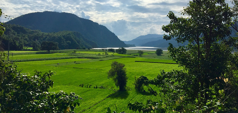 Abra Valley. Beautiful scenery of rice fields and mountains and Abra River seen on the way from the coast to Bangued.