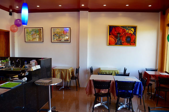 Interior of Strutz Art Café in Bangued, Abra, with paintings of the German artist Theo Strutz