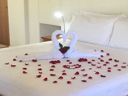 Bed decoration with rose petals for the