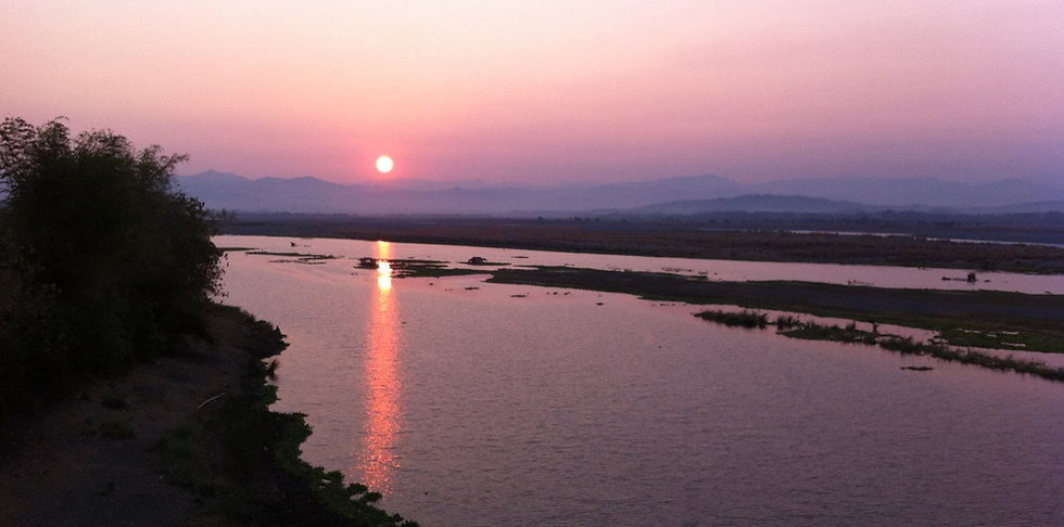 Abra River or Calaba River seen during sun set. It is a popular destination for a walk and only minutes away (on foot) from Strutz Art Garden Resort.