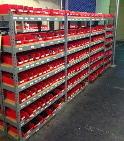 shelf-bins-holding-supplies-in-warehouse