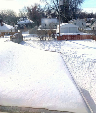 View from upstairs to back yard