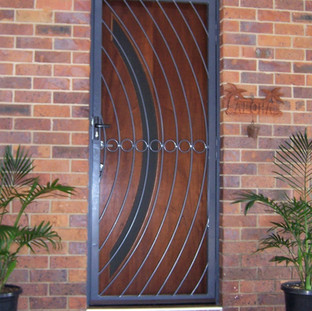 A wrought iron security door to match the design of the front door.