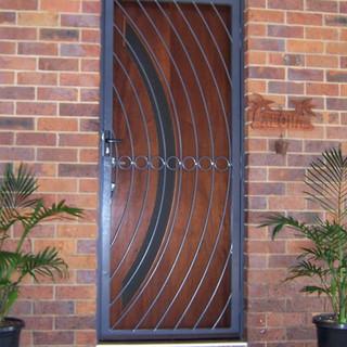 A wrought iron security door to match the design of the front door.