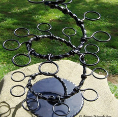 """Sugar fix"" A wrought iron wedding stand for cup cakes."