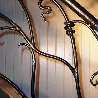 """Sweeping vine"" balustrade detail view."