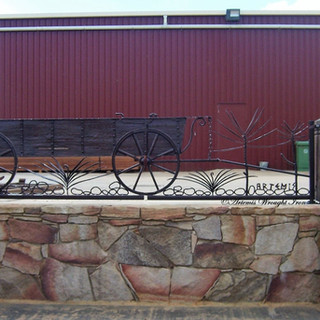 "The ""Chuck Wagon"". Featuring hammered and textured solid flat bar body, forged solid iron wheels,hot rivets and forged plant forms."