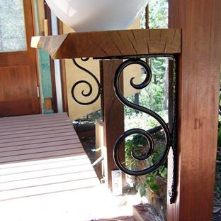 Wrought iron brackets for outdoor sink fixture.