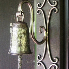 """Ding ding"" A polished wrought iron doorbell."