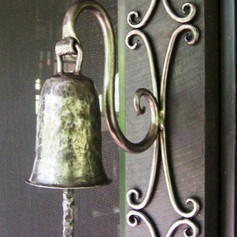 """""""Ding ding"""" A polished wrought iron doorbell."""