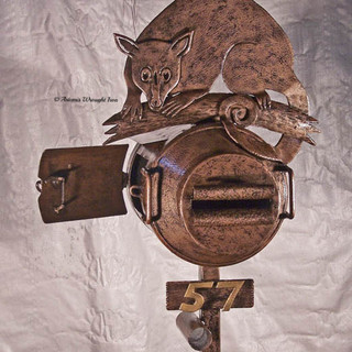 """The """"Possum"""" mailbox. Featuring an antique milk can with side access door and free-hand oxy cut possum."""