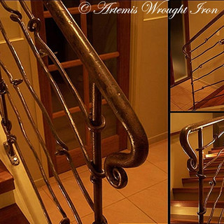 """""""Free Form"""" wrought iron balustrade features vertically scrolled newell post and horizontal pickets."""