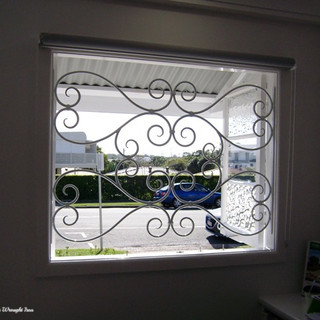 A simply elegant yet secure wrought iron window grill.