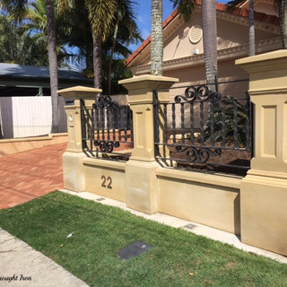 Solid wrought iron decorative screens for rendered front wall.